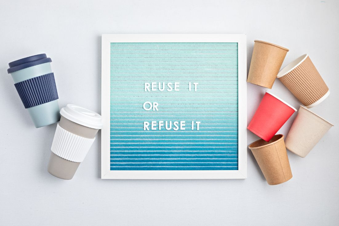 reusable vs disposable coffee cups and letterboard 23F75Q4 1